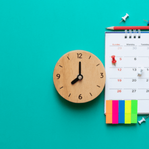 calendar and clock with post-it notes to indicate a schedule