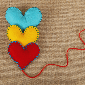 3 felt hearts, arranged in a line with a piece of string - heart connection