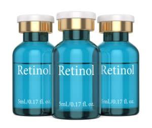 3d render of retinol vials over white background
