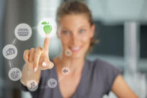 Diet concept. Touch screen food and drink. Pointing to healthy food to combat pcos hormonal acne