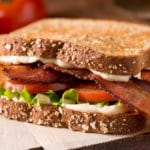 gluten free BLT sandwich on brown paper