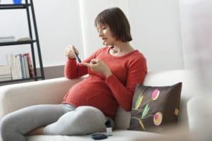 pregnant woman testing blood sugars - gestational diabetes