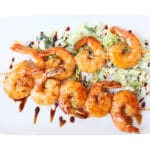 shrimps skewers on white plate