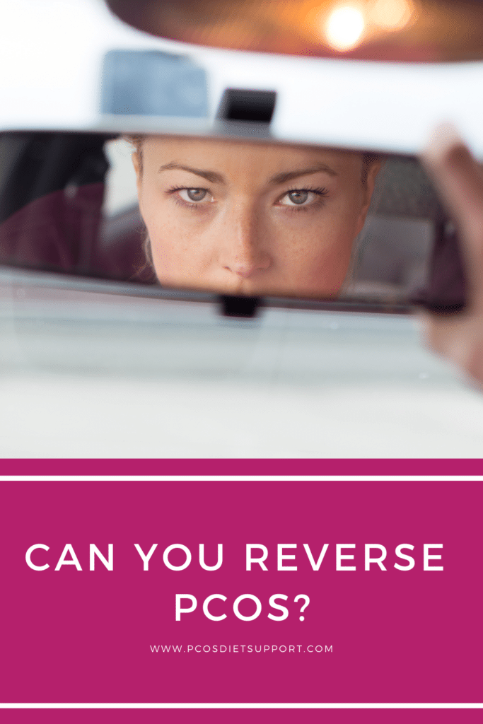 Woman looking in the review mirror. pinterest image for can you reverse pcos